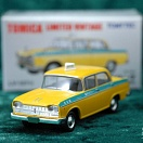 LV-127a - nissan cedric taxi (yellow) (Tomica Limited Vintage Diecast 1/64)